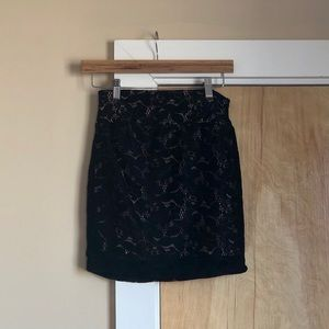 Lined black skirt with lace detail